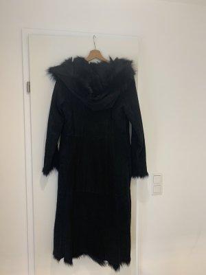 Manteau de fourrure noir pelage