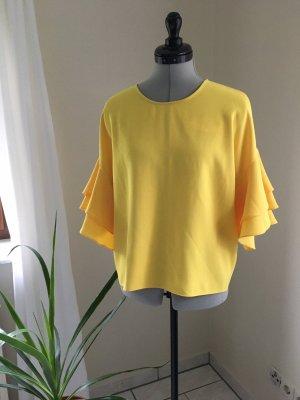 Mango Top z falbanami żółty