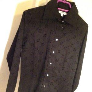 wundervolle Bluse mit Lochmuster in schwarz von Calvin Klein, XS