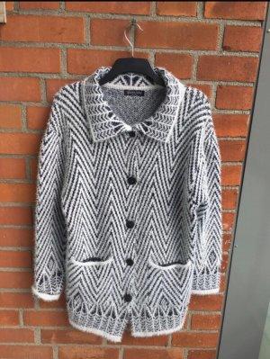 Manteau en tricot gris-blanc
