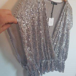 Zara Blusa brillante argento