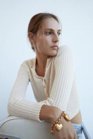 Zara Armbandje met bedels goud