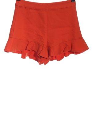 Zara Pantalón corto rojo look casual