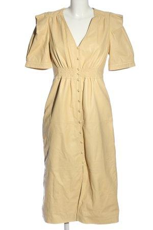 Zara Vestido de cuero crema look casual