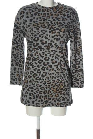 Zara Jersey largo estampado repetido sobre toda la superficie look casual