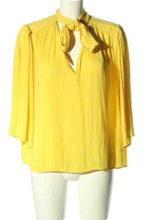 Zara Blusa con lazo amarillo pálido look casual