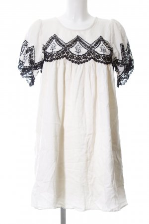 Zara Trafaluc Vestido babydoll blanco-negro Mezcla de patrones look casual