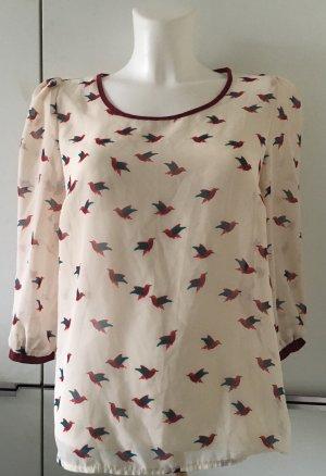 Zarte Bluse mit kleinen Vögelchen