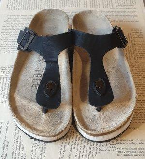 Zehensteg Sandalen