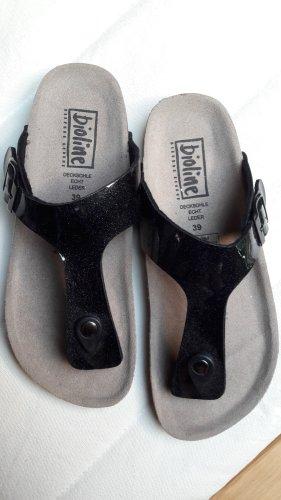 Sandalias con talón descubierto negro-marrón