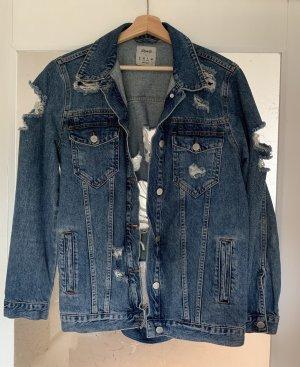 Zerrissene Jeansjacke