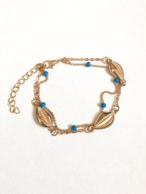 Cavigliera oro-turchese