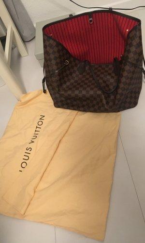 Louis Vuitton Comprador color bronce Cuero