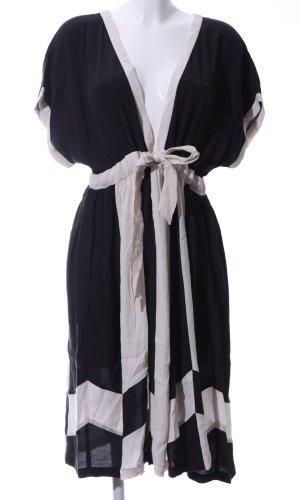 NÜMPF Kurzarmkleid schwarz-wollweiß grafisches Muster extravaganter Stil