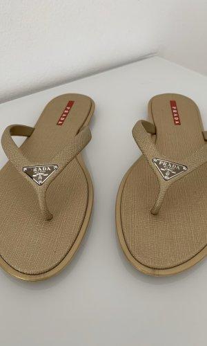 Prada Flip-Flop Sandals gold-colored