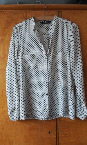 Schwarz-weiß gepunktete Bluse