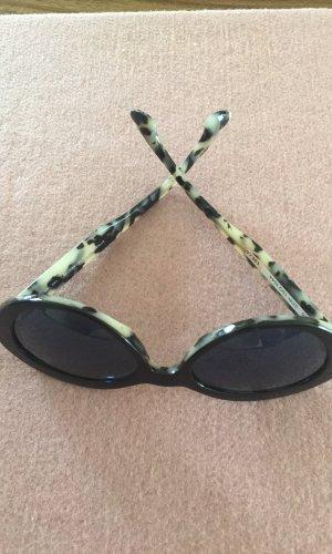 Prada Oval Sunglasses black brown-brown