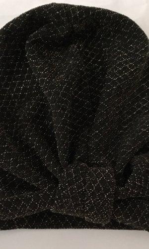 Stoffen muts zwart-goud
