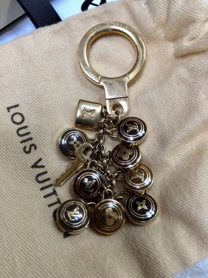 Louis Vuitton Llavero color bronce