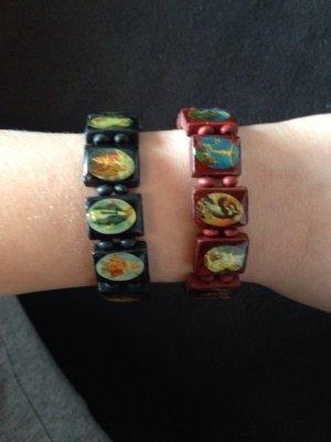 2 Armbänder mit Glaubensfiguren