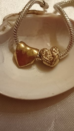 Charm gold-colored