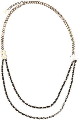 29883 Chanel sehr lange Halskette aus goldfarbenem Metall, sowie schwarzem Leder