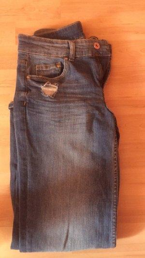 3/4 Jeans im zerrissenen Style