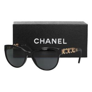 Chanel Lunettes de soleil ovales noir-doré