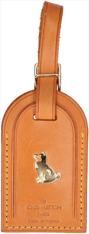 39256 Louis Vuitton Adressanhänger, Anhänger mit eingeprägtem Motiv Hund aus VVN Leder in der Farbe Braun und Gold
