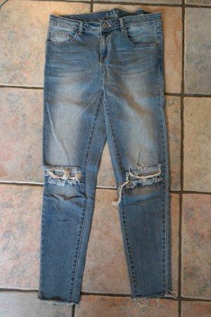 7/8 Jeans mit Löchern
