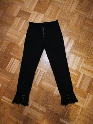 "7/8 Jeans mit ""Piercings"""