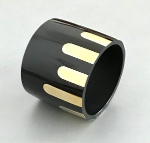 Bangle black-gold-colored synthetic material
