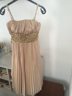 Abendkleid mit Steinen besetzt in gold