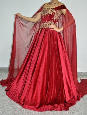 Vestido de novia color oro-burdeos