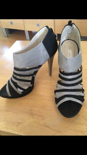 Sandales à talons hauts et lanière noir-gris