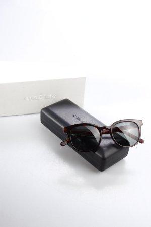 ace&tate ovale Sonnenbrille dunkelbraun Beach-Look