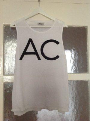 Acne Tank Top in schwarz weiß mit großen Buchstaben auf der Brust
