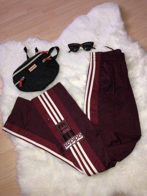 Adidas pantalonera burdeos