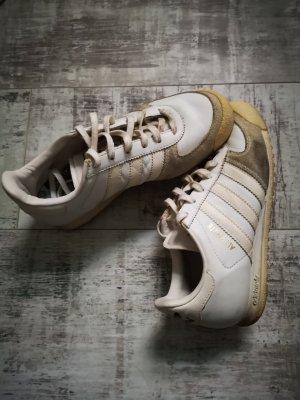 Adidas Originals Sneaker stringata bianco-oro Pelle