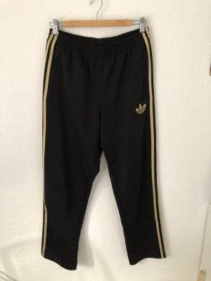 Adidas Hose mit goldenen Streifen
