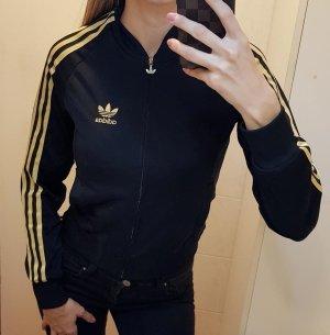 Adidas Sportjack zwart-goud