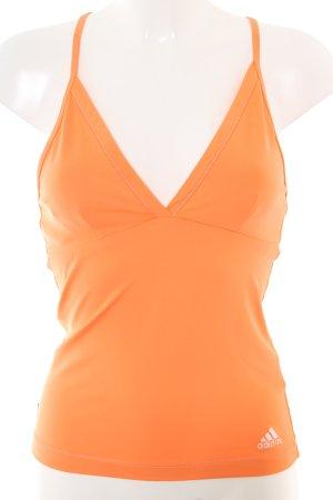 Adidas Top estilo halter naranja claro look casual