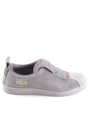 Adidas Slip-on Sneakers light grey printed lettering casual look