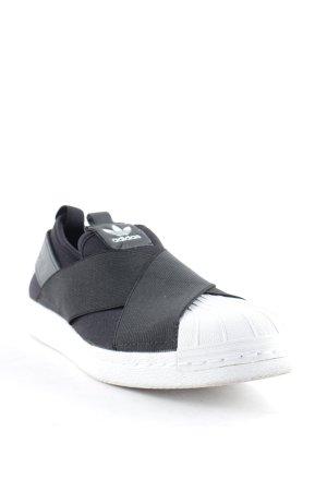 Adidas Schlüpfsneaker schwarz-weiß minimalistischer Stil