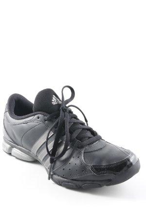 Adidas Schnürsneaker schwarz-silberfarben Streifenmuster sportlicher Stil
