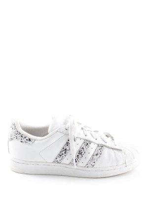 Adidas Schnürsneaker weiß-schwarz Farbtupfermuster sportlicher Stil