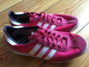 Adidas Schuhe in pink mit weißen Streifen