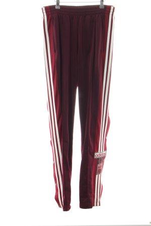 Adidas Sporthose rot-weiß Streifenmuster sportlicher Stil