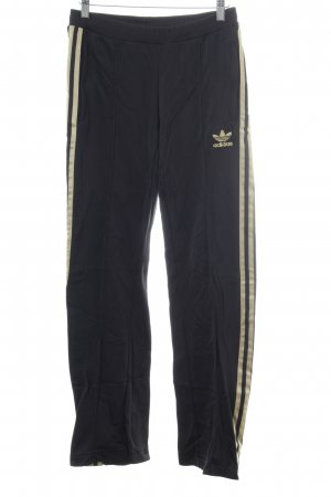 Adidas Trackies black-gold-colored striped pattern casual look