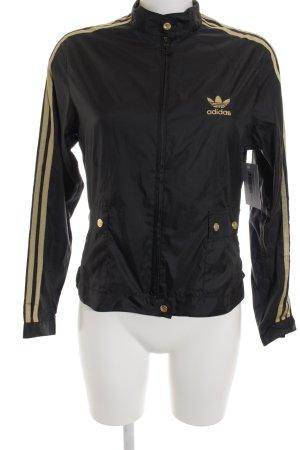 Adidas Sportjacke schwarz-goldfarben Casual-Look